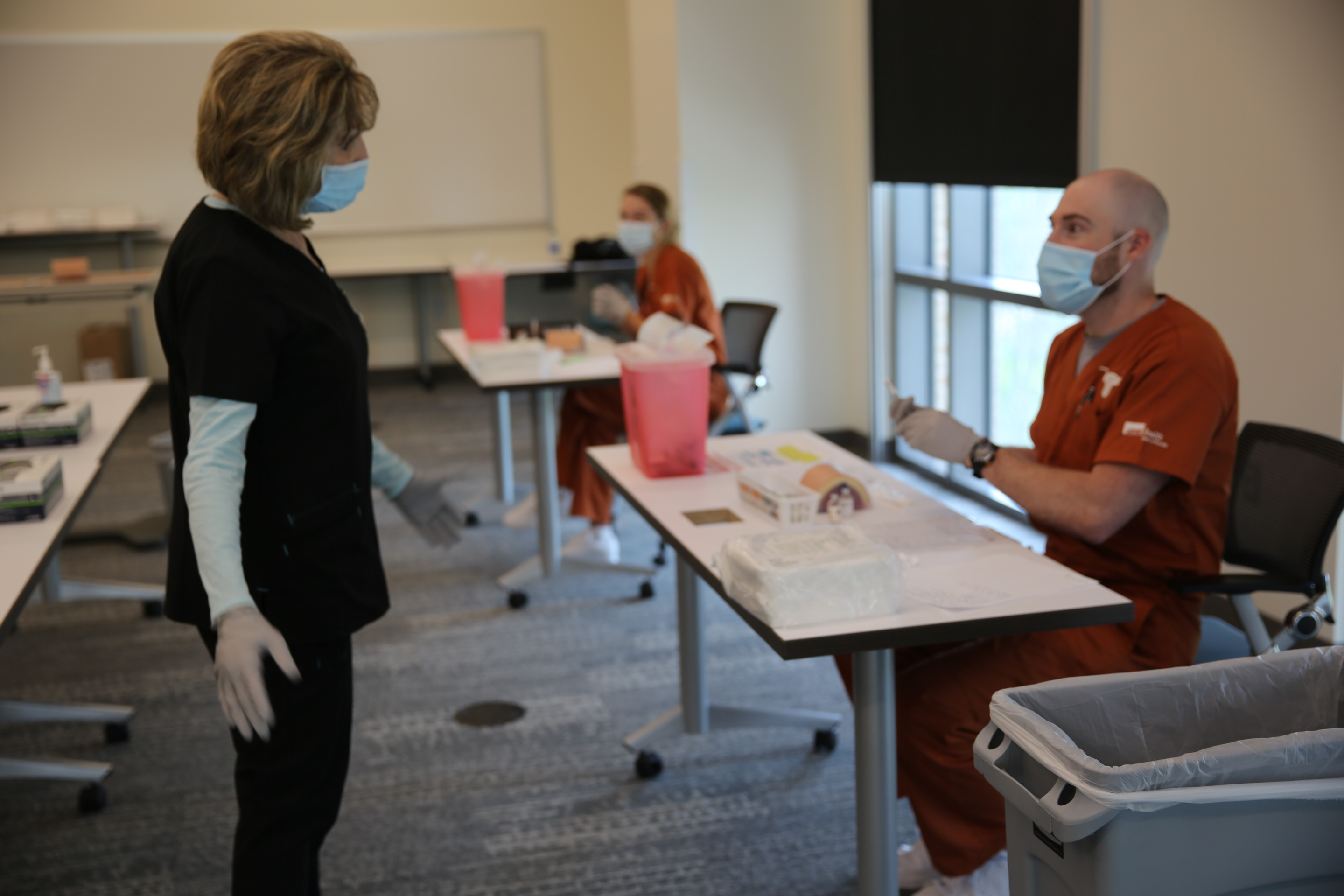 SON faculty member teaches first semester BSN students medication administration skills.